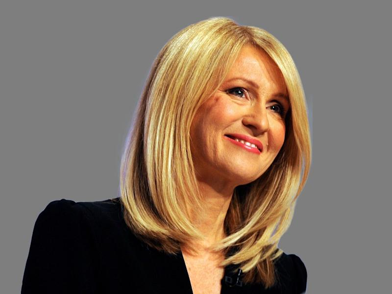 Esther McVey headshot, as Secretary of State for Work and Pensions, graphic element on gray