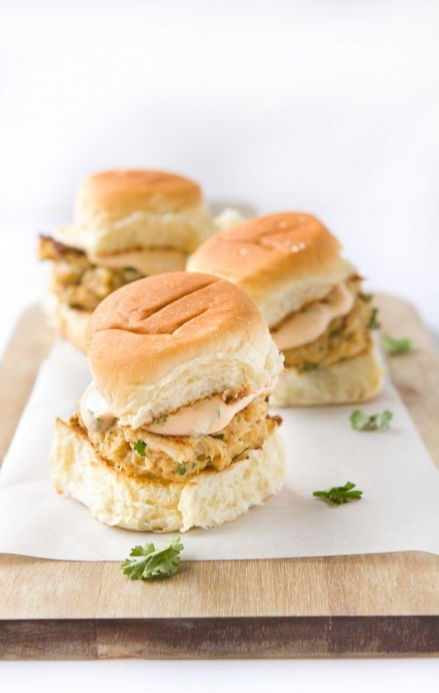 """<p>There's a reason crab cakes are one of the most-sought out party foods. Slap a bun on them and go to town. </p><p>Get the recipe from <a href=""""http://www.azestybite.com/crab-cake-sliders-spicy-aioli-sauce/"""" rel=""""nofollow noopener"""" target=""""_blank"""" data-ylk=""""slk:A Zesty Bite"""" class=""""link rapid-noclick-resp"""">A Zesty Bite</a>.</p>"""