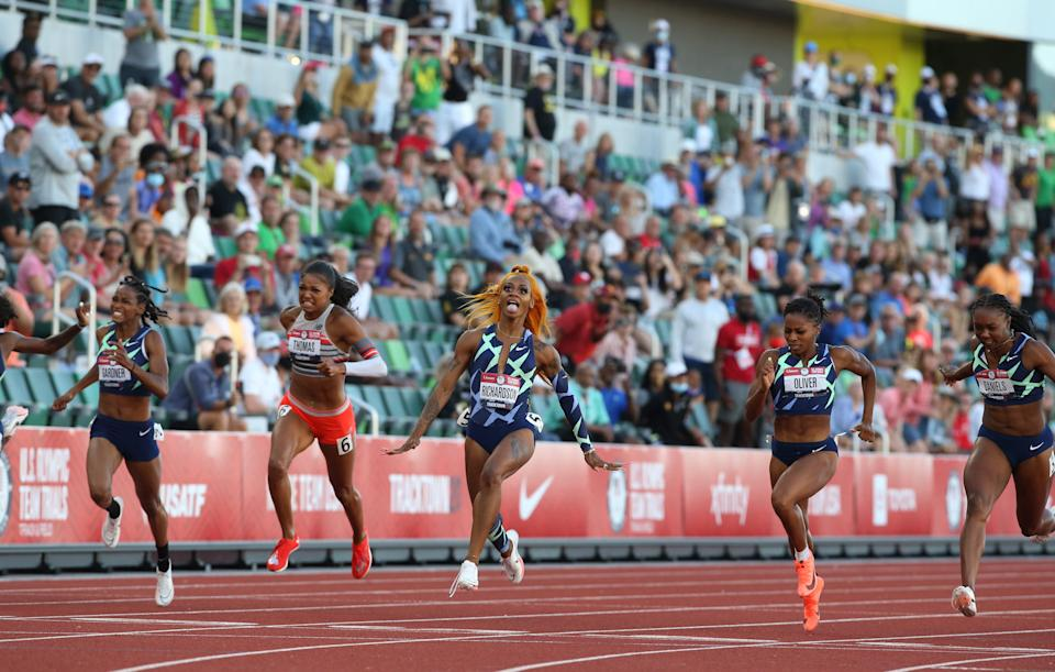 Sha'Carri Richardson, center, celebrates her win in the 100 meters at the U.S. Olympic Track & Field Trials at Hayward Field in June.