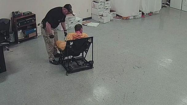 PHOTO: In this screen grab taken from a video, Pike County Deputy Jeremy Mooney is shown with restrained prisoner, Thomas Friend. (WSYX)