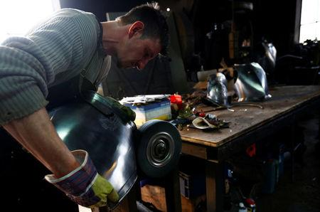 Blacksmith Schmidberger works on an suit of armour for the Vatican's Swiss Guards at his workshop in Molln