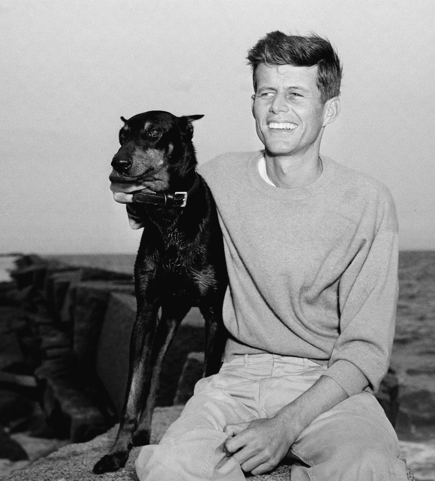 John F. Kennedy, winner of the Democratic Nomination for Congress in the 11th Massachusetts District, relaxes with his dog, Mo, June 22, 1946, Hyannisport, Mass. (AP Photo/Peter J. Carroll)