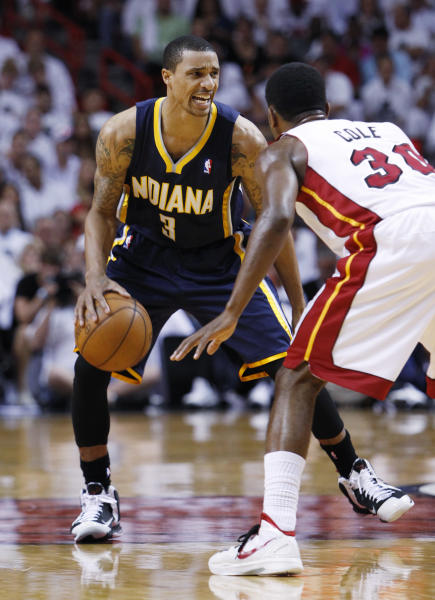 Indiana Pacers guard George Hill (3) looks for an open teammate past Miami Heat guard Norris Cole (30) during the first half of Game 2 in an NBA basketball Eastern Conference semifinal playoff series, Tuesday, May 15, 2012, in Miami. (AP Photo/Wilfredo Lee)