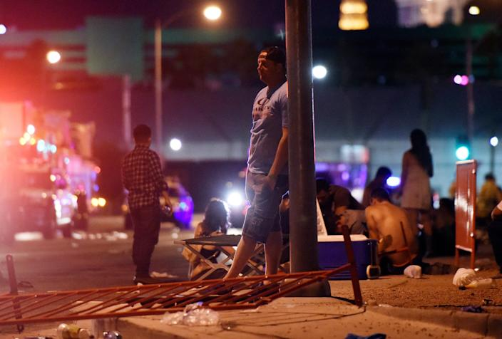 <p>A man stands outside the the Route 91 Harvest country music festival grounds after an active shooter was reported on Oct. 1, 2017 in Las Vegas, Nevada. (Photo: David Becker/Getty Images) </p>