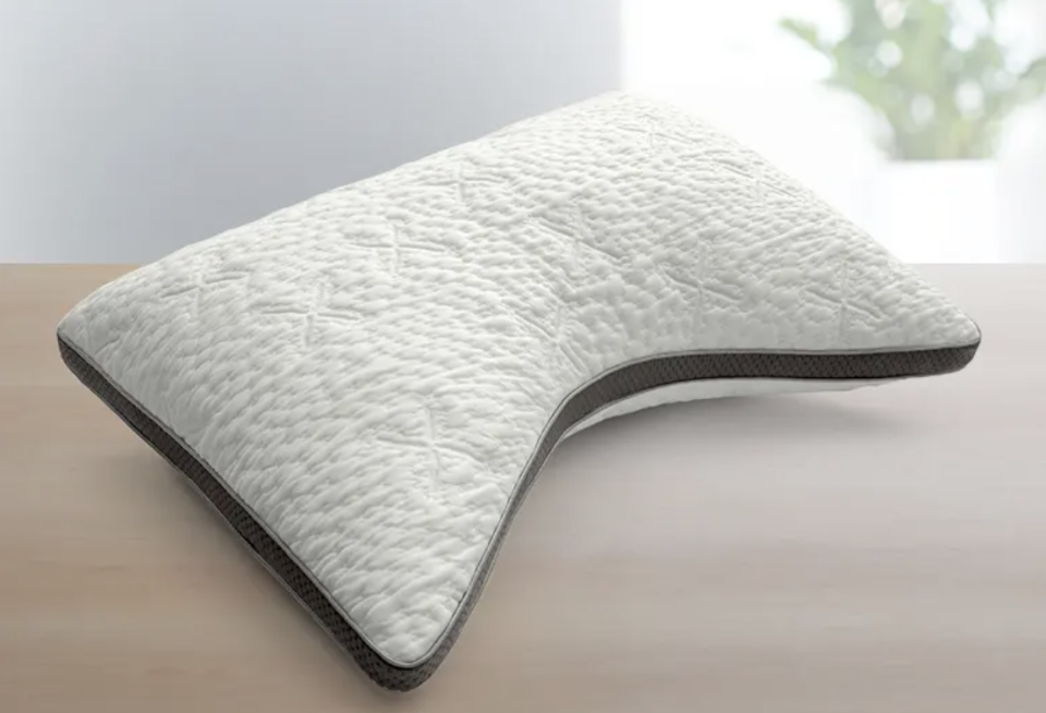 This curved Sleep Number ComfortFit pillow contours to fit your head and neck. (Photo: Sleep Number)
