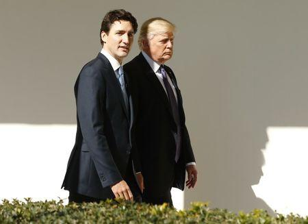 Canadian Prime Minister Trudeau walks down the West Wing colonnade with President Trump at the White House in Washington