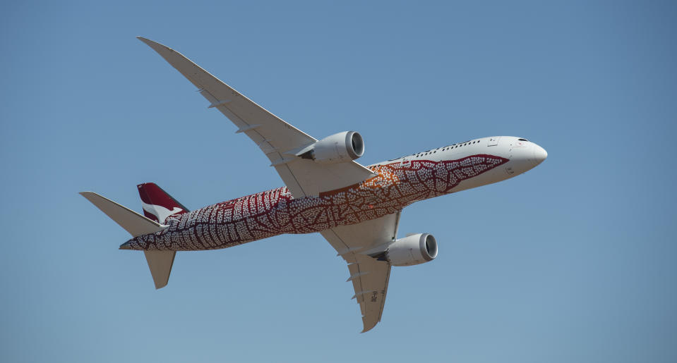 ALICE SPRINGS, AUSTRALIA - MARCH 02:  A newly painted Qantas Boeing 787 Dreamliner aircraft takes part in an air to air filming shoot on March 2, 2018 in Alice Springs, Australia. The special livery honours the work of late Northern Territory artist and Anmatyerre woman, Emily Kame Kngwarreye. It is based on her 1991 painting, Yam Dreaming, signifying the importance of the yam plant as a staple food source in her home region of Utopia, 230km north-east of Alice Springs.  (Photo by James D. Morgan/Getty Images)