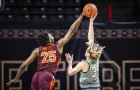 Virginia Tech forward Justyn Mutts (25) blocks a shot from Wake Forest guard Carter Whitt (35) during an NCAA college basketball game Sunday, Jan. 17, 2021, in Winston-Salem, N.C. (Andrew Dye/The Winston-Salem Journal via AP)