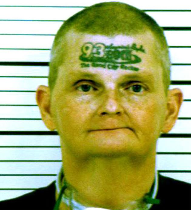 David Jonathan Winkelman, 48, has '93 Rock, the Quad city rocker' on his forehead. The Iowa man got the tattoo after a radio DJ offered a six figure sum to listeners if they tattooed the radio station's logo on their face (Rex Features)