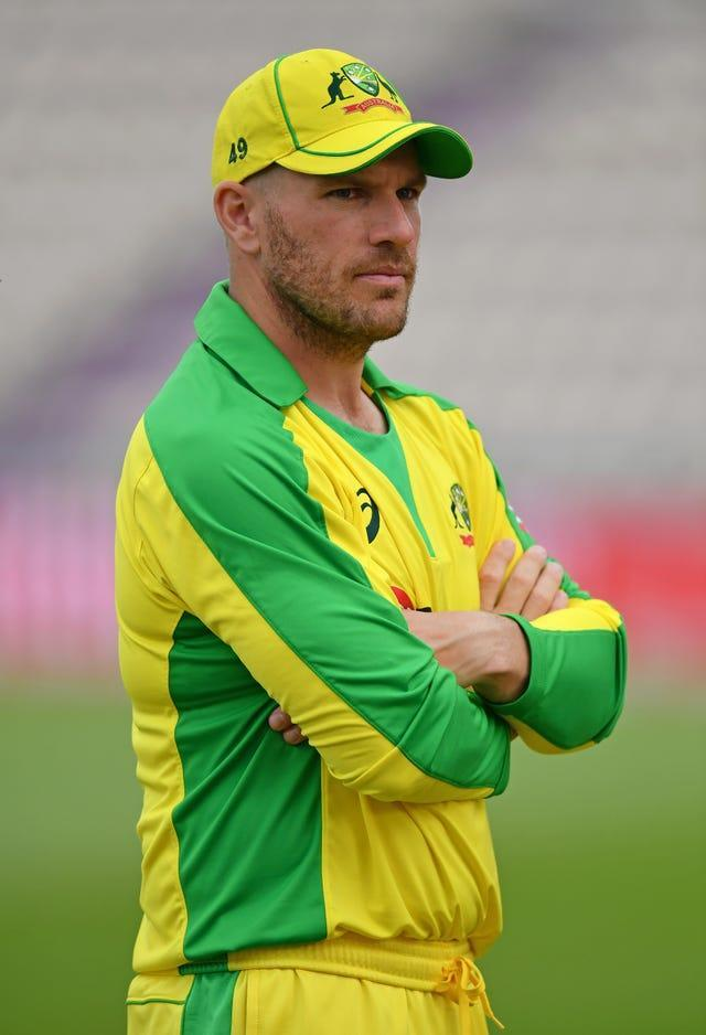 Australia's Aaron Finch crosses his arm while on the field