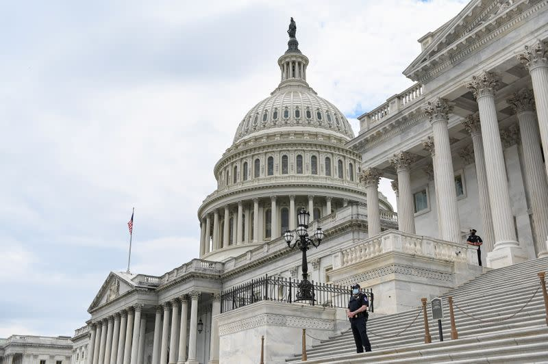 Police officers wearing face masks guard the U.S. Capitol Building in Washington
