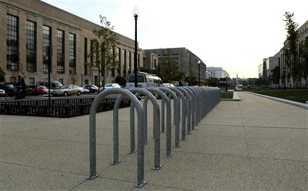 Empty bicycle racks are seen in the Federal Center Plaza area during day three of the U.S. government shutdown in Washington October 3, 2013. REUTERS/Gary Cameron