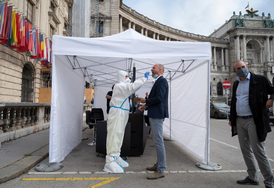 A man is tested for Covid-19 outside of the  Hofburg palace before entering an event organised by Vienna Tourism in Vienna, Austria on September