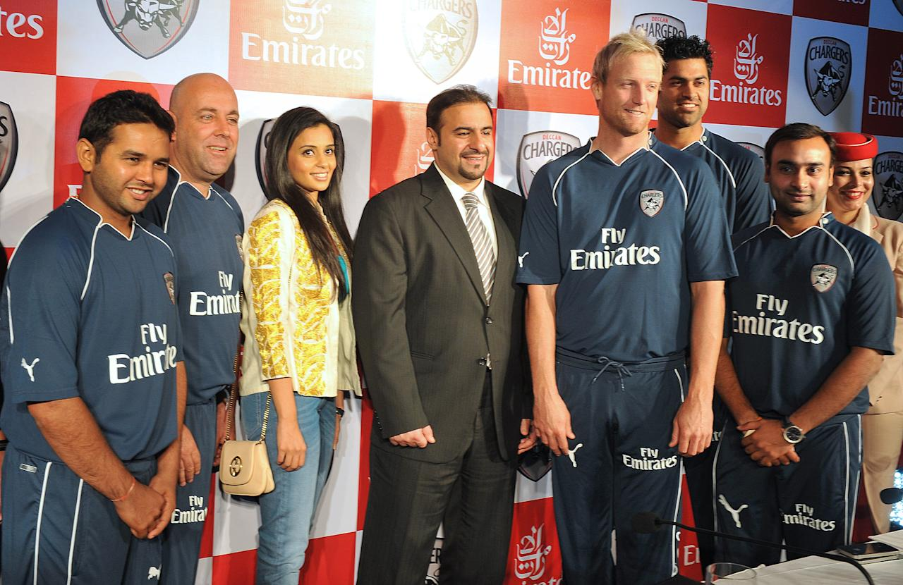 Deccan Chargers co-owner Gayatri Reddy (3rd L) and Emirates India and Nepal vice president Orhan Abbas (C) pose with team cricketers during a press conference announcing Emirates as a team sponsor in Hyderabad on March 28, 2012. AFP PHOTO / Noah SEELAM (Photo credit should read NOAH SEELAM/AFP/Getty Images)