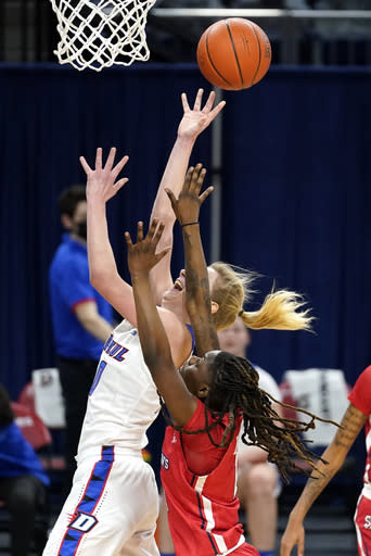 DePaul guard Lexi Held, left, shoots next to St. John's guard Unique Drake during the second half of an NCAA college basketball game in Chicago, Wednesday, Jan. 13, 2021. (AP Photo/Nam Y. Huh)