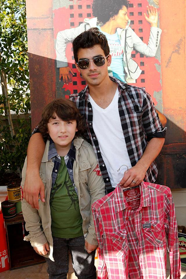 """Joe Jonas helped his youngest bro, 9-year-old Frankie, pick out a shirt. Apparently, everyone in the family is a big fan of plaid. Jordin Althaus/<a href=""""http://www.wireimage.com"""" target=""""new"""">WireImage.com</a> - June 3, 2010"""