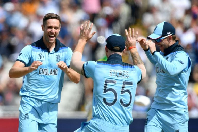 England's Chris Woakes (left) celebrates his dismissal of Australia's Peter Handscomb in the World Cup semi-final at Edgbaston
