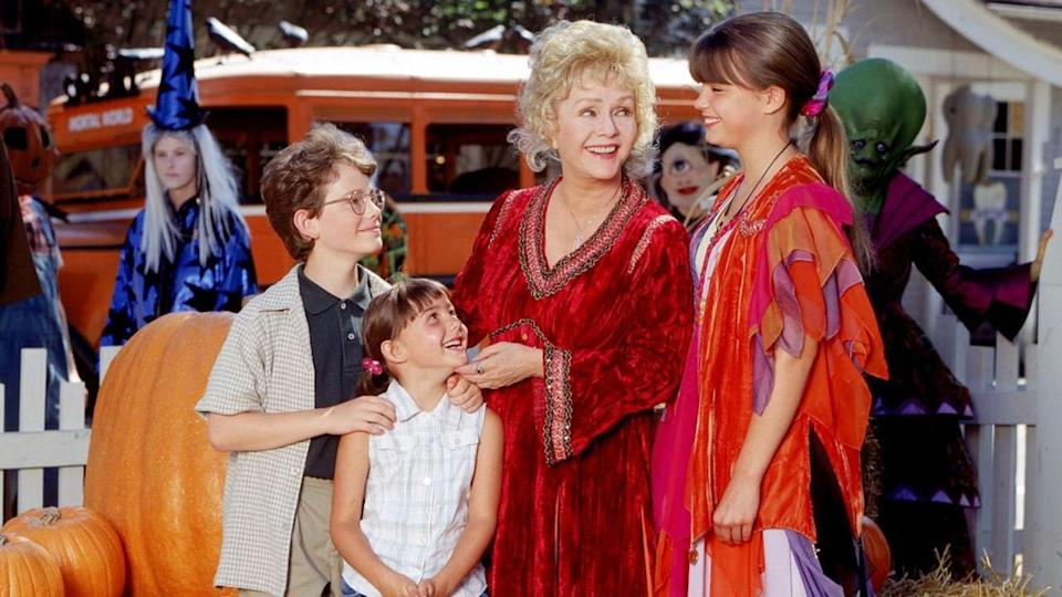 "<p> If Debbie Reynolds as a grand witch isn't enough to pique your interest then check your pulse. Halloweentown – or, as those with taste call it, ""The Best Disney Channel Original Movie Ever Made"" – tells the story of 13-year-old Marnie Piper and her grandmother Aggie, who's secretly a witch. Aggie visits every year during All Hallow's Eve, and when she heads home to her mysterious town, Marnie and her siblings secretly hitch a ride. They end up in – you guessed it – Halloweentown, a magical place full of skeletal taxi drivers and goblin boys. Something evil is afoot, and it's up to Marnie, her siblings, and their reluctant mother to save the day. </p> <p> Very few witchy movies successfully mix palatable scariness and 'aw shucks' moments the way Halloweentown does. Watch this after you've had one too many pumpkin beers and you'll be swooning over Debbie Reynolds' extensive velvet wardrobe. </p>"