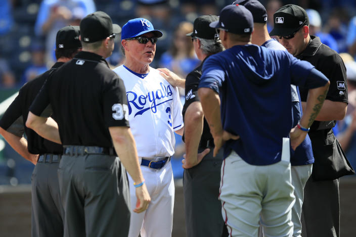 Kansas City Royals manager Ned Yost (3) exchanges lineup cards before a baseball game against the Minnesota Twins at Kauffman Stadium in Kansas City, Mo., Sunday, Sept. 29, 2019. Yost is managing his last game for the Royals. (AP Photo/Orlin Wagner)