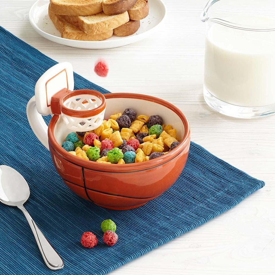 <p>Make breakfast fun with this <span>mug with a hoop</span> ($25). </p>