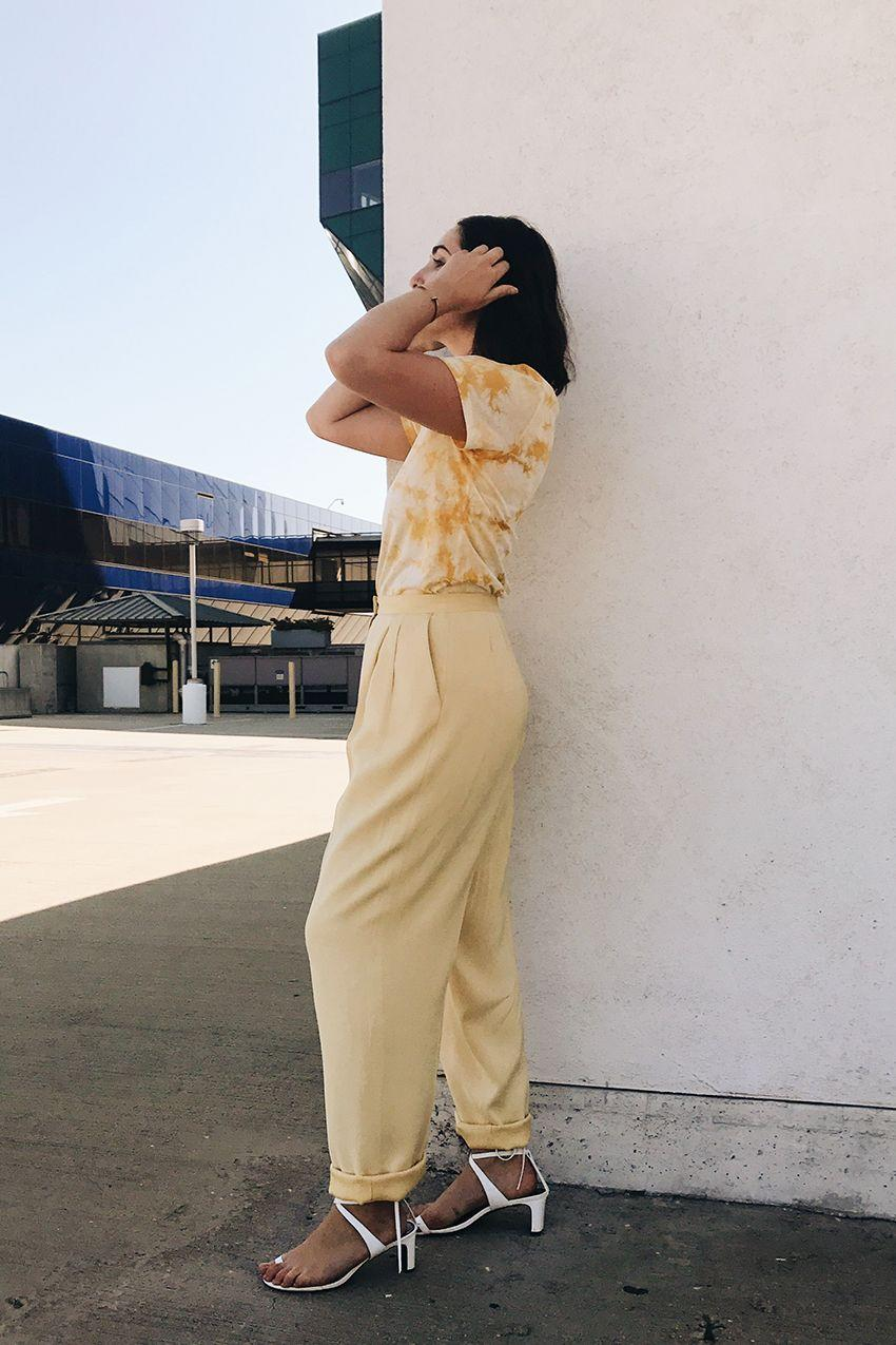 I played around with pattern, pairing a whimsical tie-dye T-shirt with solid trousers and went for white sandals to freshen the whole thing up.