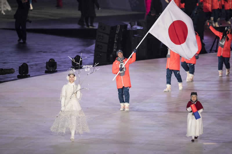 Team Japan enters the Opening Ceremony on Friday. More