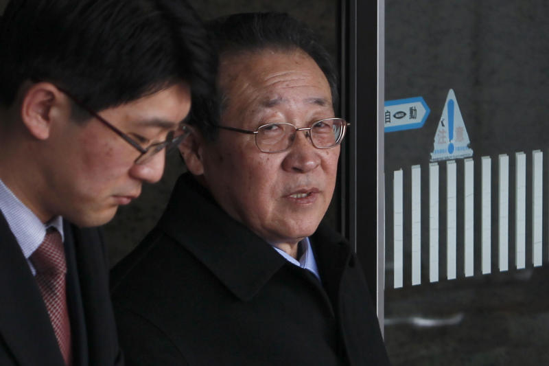 North Korean First Vice Foreign Minister Kim Kye Gwan, right, arrives at Beijing's Capital International Airport, China, Tuesday, Feb. 21, 2012. North Korea's top nuclear envoy arrived in Beijing ahead of important nuclear talks with the United States later this week. (AP Photo/Alexander F. Yuan)