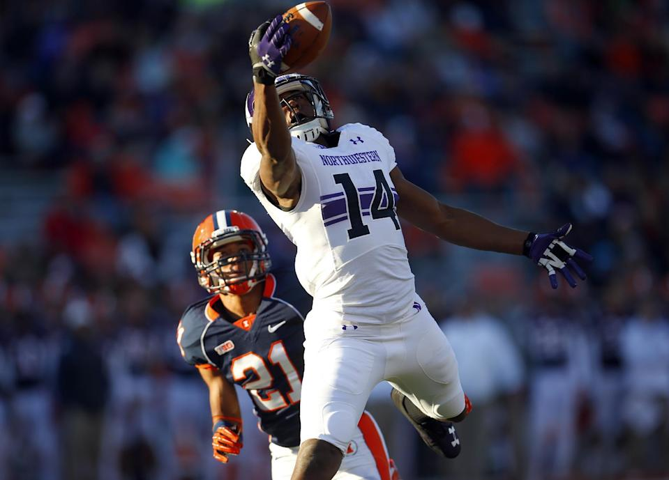 Northwestern wide receiver Christian Jones (14) catches a touchdown pass in front of Illinois defensive back Zane Petty (21) during the first half of an NCAA college football game on Saturday, Nov. 30, 2013, in Champaign, Ill. (AP Photo/Jeff Haynes)