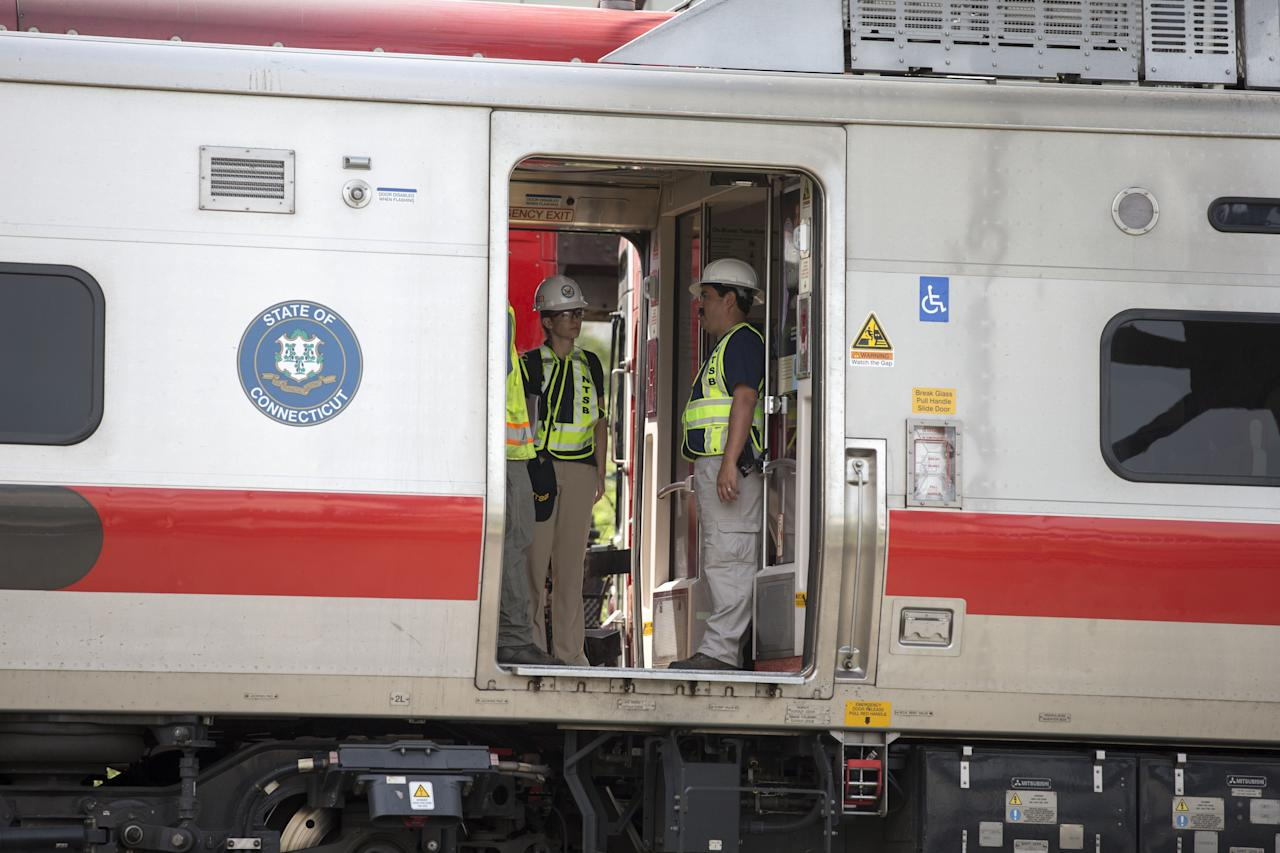 FAIRFIELD, CT - MAY 18: NTSB investigators examine the scene of a Metro North train collision on May 18, 2013 in Fairfield, Connecticut. Two New Haven Line Metro North commuter trains collided on Friday, May 17 near Bridgeport, CT, injuring as many as 70 people.  (Photo by Michael Graae/Getty Images)