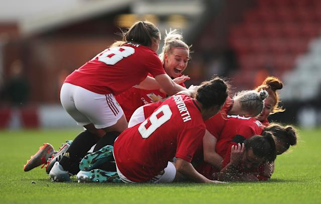 Manchester United's Katie Zelem celebrates scoring their first goal with team mates (Action Images via Reuters/Molly Darlington)