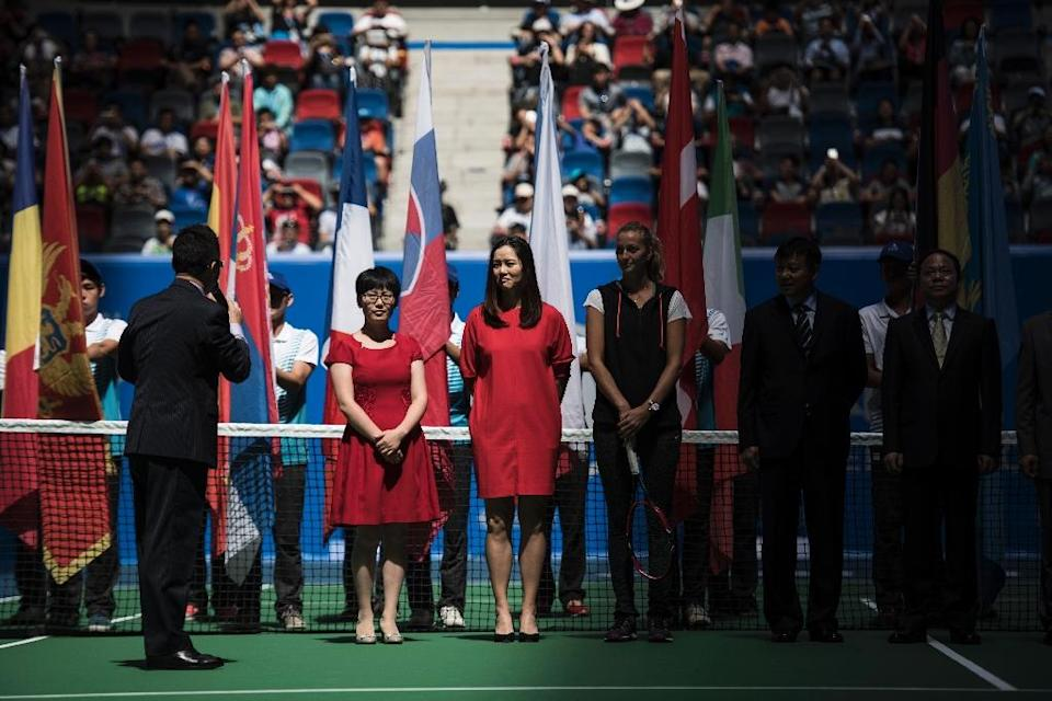 Former tennis player Li Na (C) attends the opening ceremony of the Wuhan Open tournament, in China's Hubei province, on September 27, 2015 (AFP Photo/Fred Dufour)