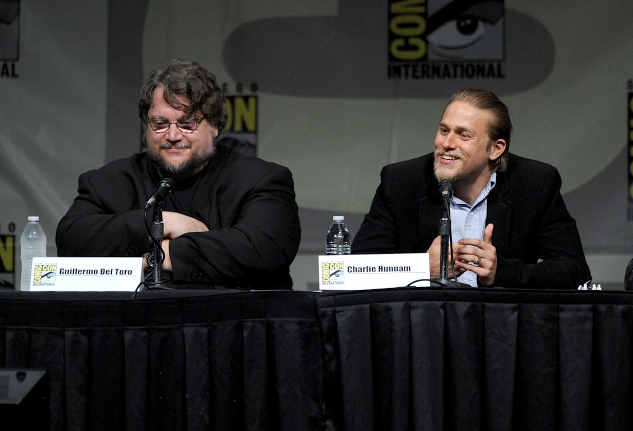 """SAN DIEGO, CA - JULY 14:  Director Guillermo del Toro (L) and actor Charlie Hunnam speak at Warner Bros. Pictures and Legendary Pictures Preview of """"Pacific Rim"""" during Comic-Con International 2012 at San Diego Convention Center on July 14, 2012 in San Diego, California.  (Photo by Kevin Winter/Getty Images)"""