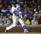 Chicago Cubs' Javier Baez hits a home run against the New York Mets during the seventh inning of a baseball game Thursday, June 20, 2019, in Chicago. (AP Photo/Jim Young)