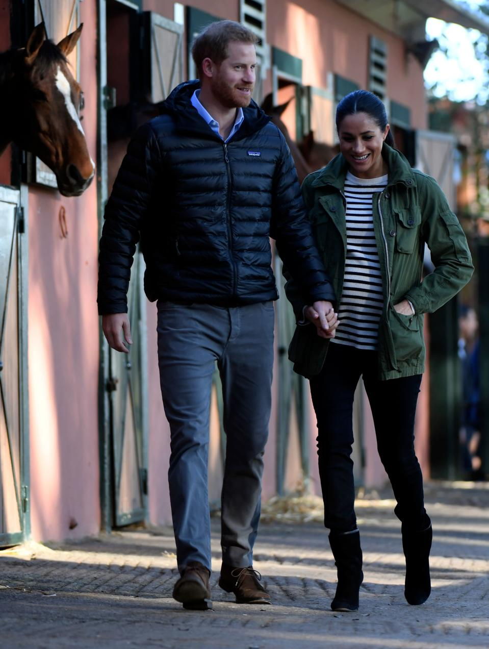 """<p>At the Moroccan Royal Federation of Equestrian Sports in Rabat, Meghan donned her trusty khaki <a rel=""""nofollow noopener"""" href=""""https://www.jcrew.com/uk/p/E0945"""" target=""""_blank"""" data-ylk=""""slk:J. Crew 'Field Mechanic' jacket"""" class=""""link rapid-noclick-resp"""">J. Crew 'Field Mechanic' jacket</a> with a striped sweater by French label Equipment, <a rel=""""nofollow noopener"""" href=""""https://www.shopbop.com/maternity-skinny-jeans-rag-bone/vp/v=1/1583789317.htm?fm=search-viewall-shopbysize&os=false"""" target=""""_blank"""" data-ylk=""""slk:Rag & Bone skinny maternity jeans"""" class=""""link rapid-noclick-resp"""">Rag & Bone skinny maternity jeans</a> and <a rel=""""nofollow noopener"""" href=""""https://www.saksfifthavenue.com/stuart-weitzman-brooks-suede-booties/product/0400098880069?ranMID=37410&ranEAID=0RpXOIXA500&ranSiteID=0RpXOIXA500-iO3_3OiVQ9vCW041Q7wYNw&site_refer=AFF001&mid=37410&siteID=0RpXOIXA500-iO3_3OiVQ9vCW041Q7wYNw&ranMID=37410&ranEAID=QFGLnEolOWg&ranSiteID=QFGLnEolOWg-YClXUJnqTO6CYl13MTopfA&site_refer=AFF001&mid=37410&siteID=QFGLnEolOWg-YClXUJnqTO6CYl13MTopfA"""" target=""""_blank"""" data-ylk=""""slk:Stuart Weitzman heeled boots"""" class=""""link rapid-noclick-resp"""">Stuart Weitzman heeled boots</a>. [Photo: Getty] </p>"""