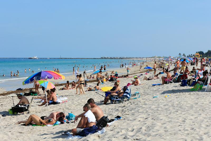MIAMI BEACH, FLORIDA - JUNE 10: Beachgoers take advantage of the opening of South Beach on June 10, 2020 in Miami Beach, Florida. Miami-Dade county and the City of Miami opened their beaches today as the area eases restrictions put in place to contain COVID-19. (Photo by Cliff Hawkins/Getty Images)
