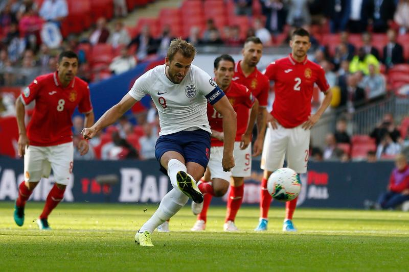 England's striker Harry Kane shoots from the penalty spot to score his team's second goal during the UEFA Euro 2020 qualifying first round Group A football match between England and Bulgaria at Wembley Stadium in London on September 7, 2019. (Photo by Ian KINGTON / AFP) / NOT FOR MARKETING OR ADVERTISING USE / RESTRICTED TO EDITORIAL USE (Photo credit should read IAN KINGTON/AFP/Getty Images)