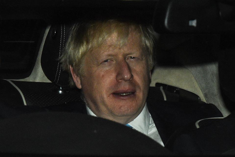 Prime minister Boris Johnson leaves Parliament after losing a Commons vote to force an early election