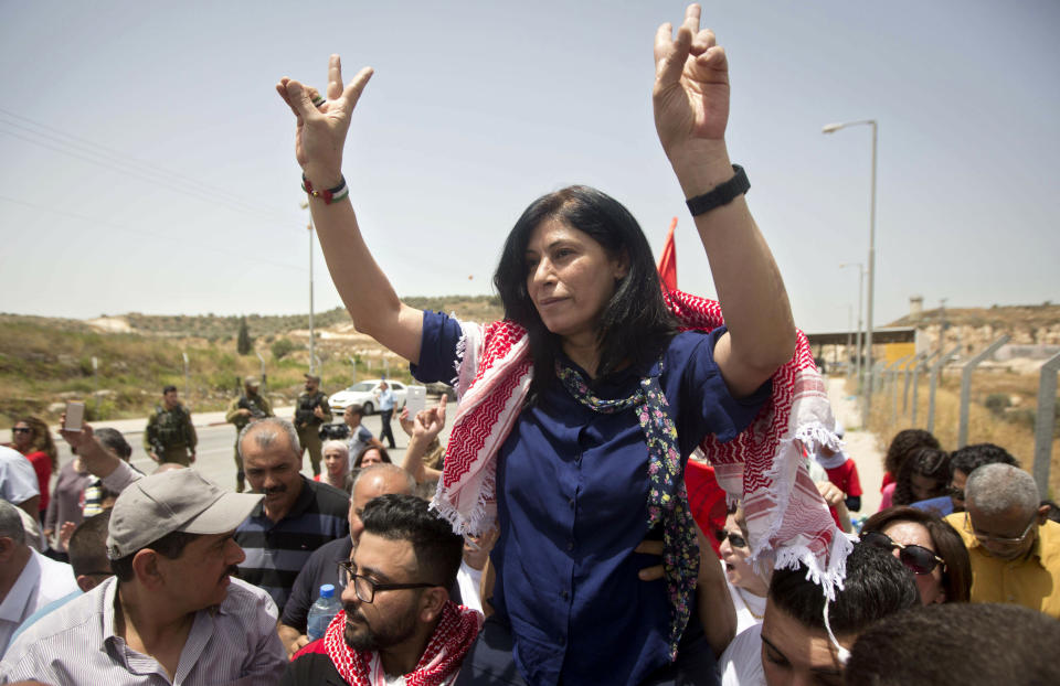 FILE - In this June 3, 2016 file photo, Palestinian lawmaker Khalida Jarrar is greeted by supporters after her release from an Israeli prison near the West Bank town of Tulkarem. An Israeli military court has sentenced Jarrar, Tuesday, March 2, 2021, to two years in prison in a plea bargain that convicted her of belonging to an outlawed group but dropped the most serious charges against her. (AP Photo/Majdi Mohammed, File)