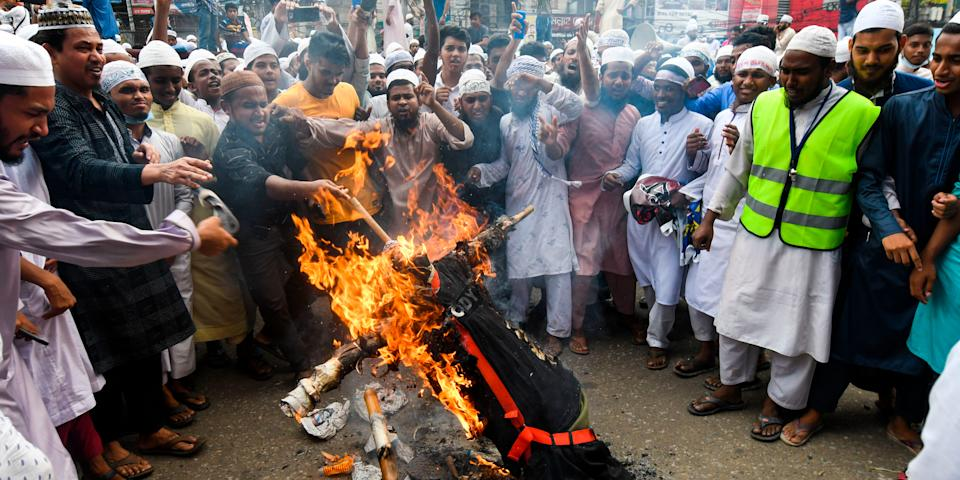 Protesters burn an effigy of French President Emmanuel Macron during an anti-France demonstration in Dhaka on November 2, 2020. Image used for representational purpose only. Photo: Munir Uz Zaman/AFP via Getty Images