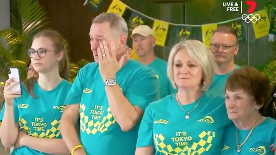 Pictured here, Ariarne Titmus' family watching her win a gold medal in Tokyo from back home in Australia.