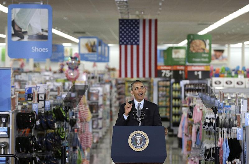 President Barack Obama speaks at a Walmart store in Mountain View, Calif., Friday, May 9, 2014. Obama announced new steps by companies, local governments and his own administration to deploy solar technology, showcasing steps to combat climate change that don't require consent from a disinclined Congress. (AP Photo/Jeff Chiu)
