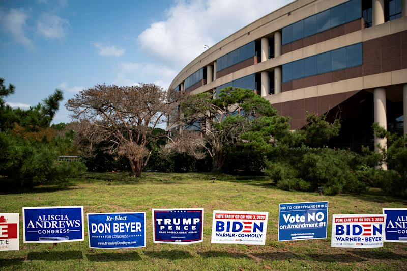 Yard signs supporting U.S. President Donald Trump and Democratic U.S. presidential nominee and former Vice President Joe Biden are seen during early voting for the 2020 U.S. presidential election at the Fairfax County Government Center in Fairfax, Virginia, U.S., September 18, 2020. REUTERS/Al Drago