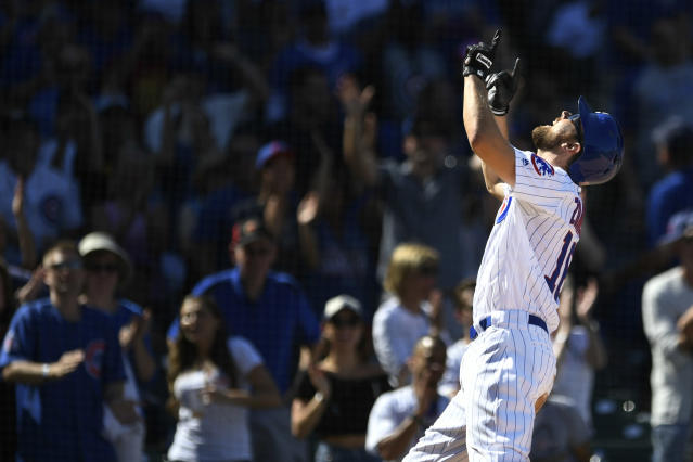 Chicago Cubs' Ben Zobrist celebrates at home plate after hitting a solo home run during the third inning of a baseball game against the Pittsburgh Pirates Saturday, Sept. 14, 2019, in Chicago. (AP Photo/Paul Beaty)