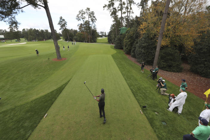 Tiger Woods tees off on the 18th hole during the first round of the Masters golf tournament Thursday, Nov. 12, 2020, in Augusta, Ga. (Curtis Compton/Atlanta Journal-Constitution via AP)