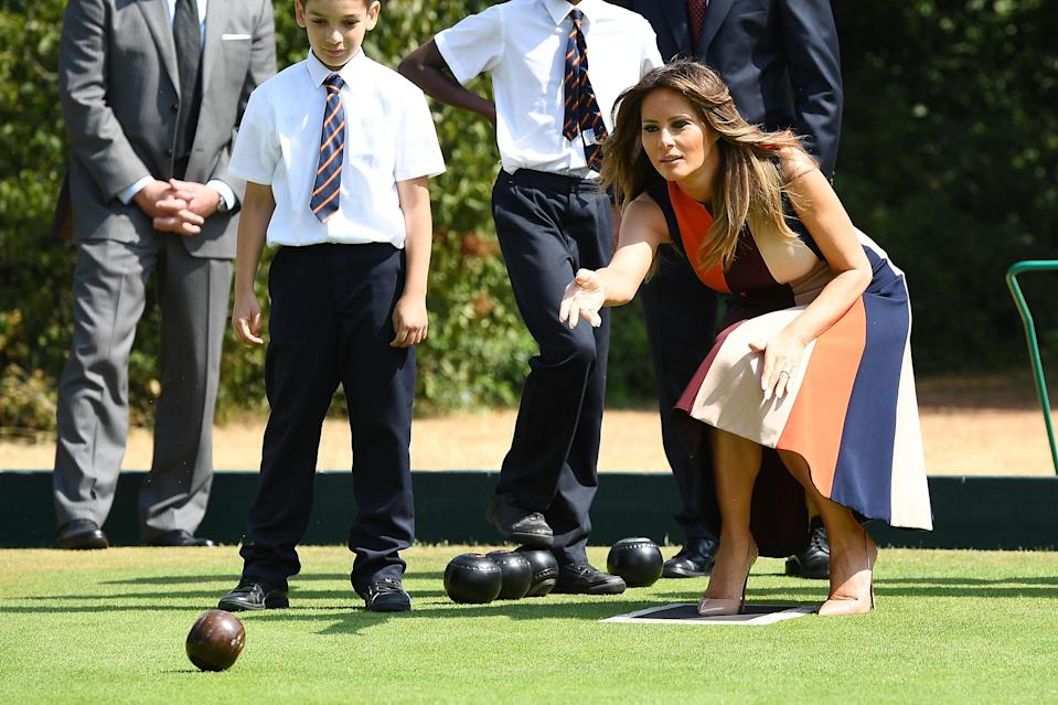 FLOTUS played bowls with schoolchildren during her visit to London. (Photo: Leon Neal/Getty Images)