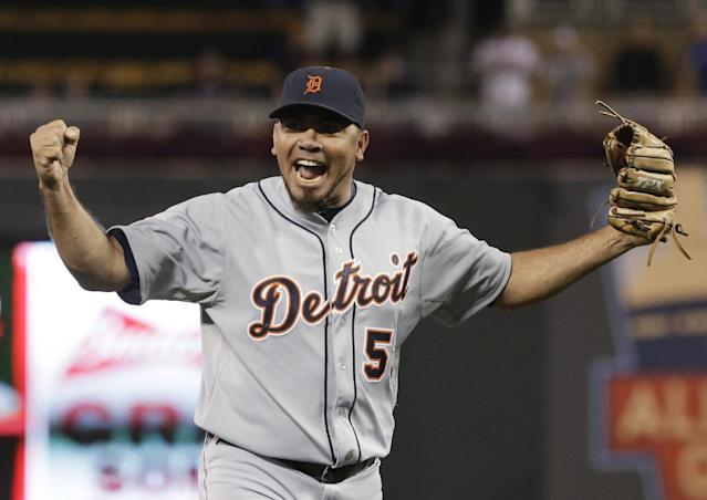 FILE - In this Sept. 25, 2013 file photo, Detroit Tigers pitcher Joaquin Benoit celebrates after striking out Minnesota Twins' Josh Willingham to end a baseball game in Minneapolis. A person familiar with the situation says the San Diego Padres have agreed with former Detroit Tigers closer Joaquin Benoit on a $15.5 million, two-year contract. The person spoke on condition of anonymity Wednesday, Dec. 18, 2013, because the deal is pending on Benoit passing a physical. (AP Photo/Jim Mone, File)