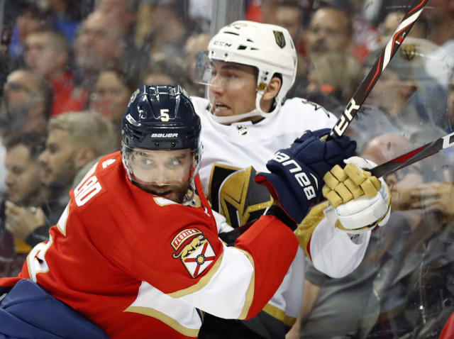 Florida Panthers defenseman Aaron Ekblad (5) slams Vegas Golden Knights left wing Tomas Nosek into the boards during the first period of an NHL hockey game, Saturday, Feb. 2, 2019 in Sunrise, Fla. (AP Photo/Wilfredo Lee)