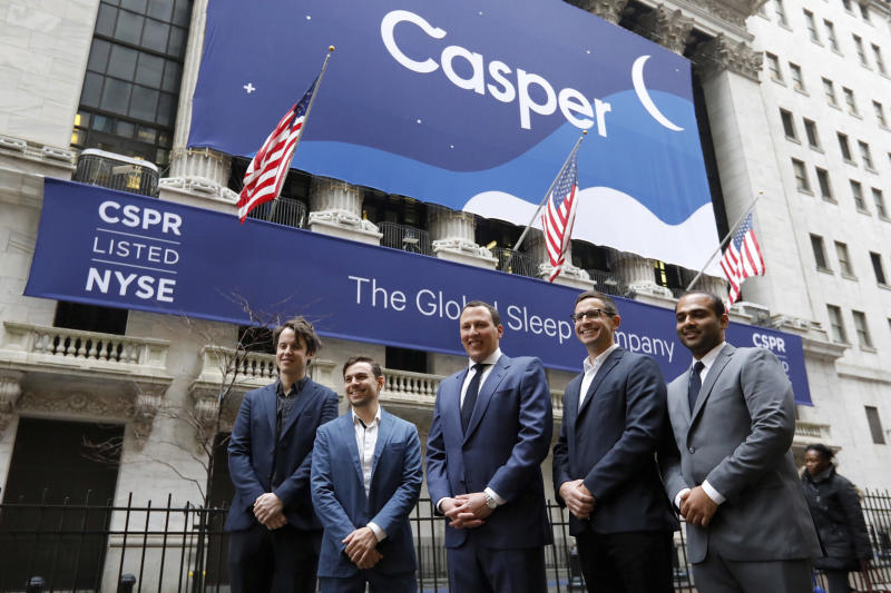 Co-founders of sleep product company Casper: Luke Sherwin, Gabe Flateman, CEO Philip Krim, Jeff Chapin and Neil Parikh, left to right, pose for a photo outside of the New York Stock Exchange, before their IPO, Thursday, Feb. 6, 2020. (AP Photo/Richard Drew)