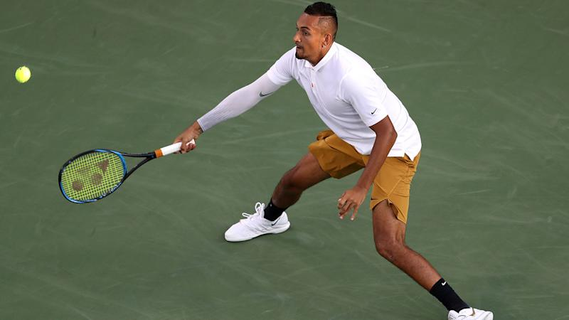 Nick Kyrgios returns a shot to Lorenzo Sonego. (Photo by Rob Carr/Getty Images)