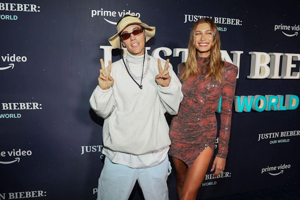 """Justin Bieber, left, and wife Hailey Baldwin at Tuesday's premiere of """"Justin Bieber: Our World"""" in New York."""